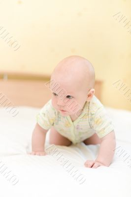 Toddler crawling on bed