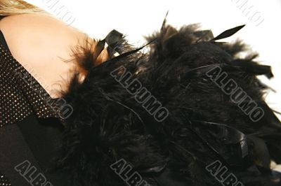 women`s shoulder with black feather boa