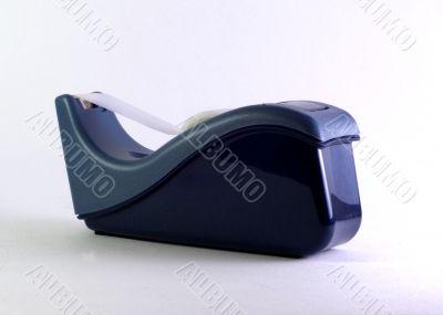 tape dispenser on  white surface