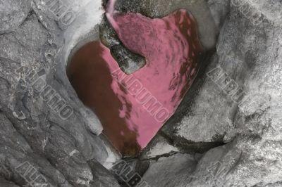 heart-shaped lake in rocks