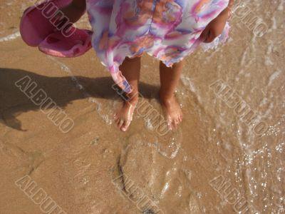 legs on sea sand