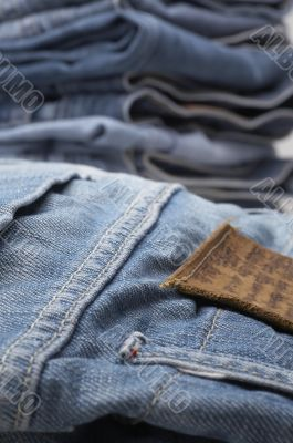 the heap of modern designer blue jeans