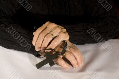 Old hands with black cross