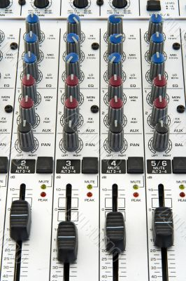 Faders and knobs of sound mixer