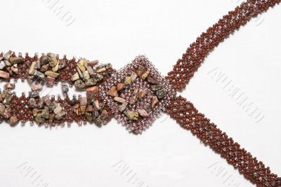 Fragment of a necklace from beads .