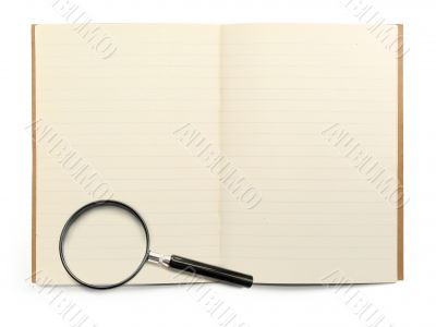 exercise book and magnifying glass