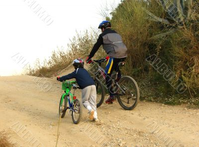 father and the son with bicycles