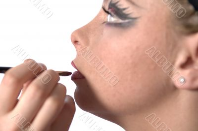 Make up artist applying lipstick
