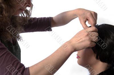 Hair dresser artist working on hair