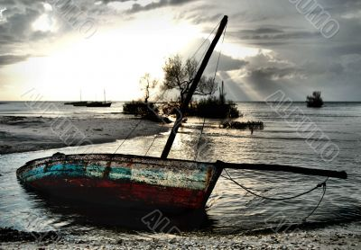 Dhow Sailing boat stranded at low tide in ocean