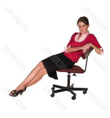 Professional  lady leaning back in office chair