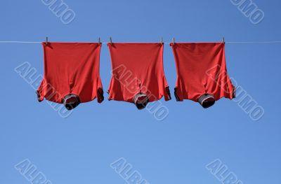 Laundry, three red t-shirts