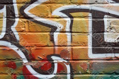 Bright graffiti on a peeling wall
