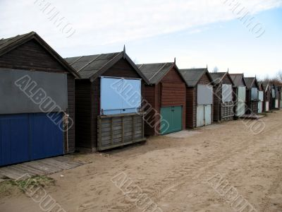 A row of beach huts during the winter months.