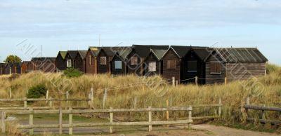 Beach huts on sand dunes
