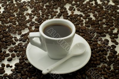 white cup of coffee with a coffee beans