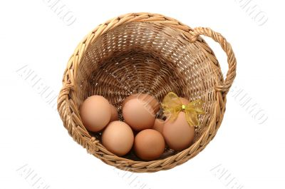 few eggs in a basket with decorated one