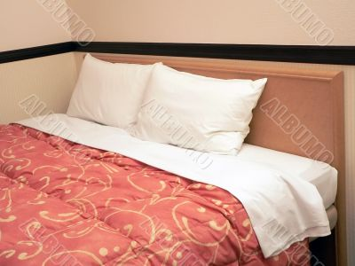 double bed with two pillows