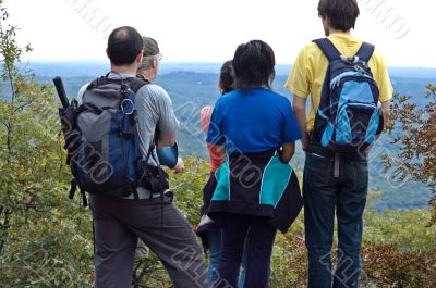 Group of students standing on the mountain top