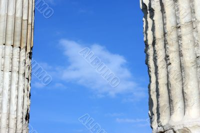 Blue clouded sky between two ancient Greek columns