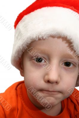 Boy in Santa cap