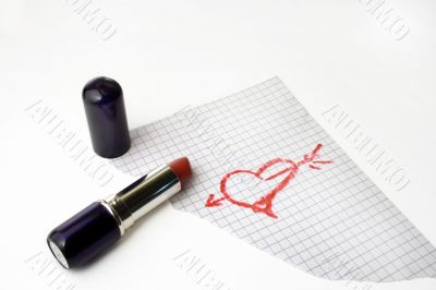 Heart drawn by lipstick on a paper