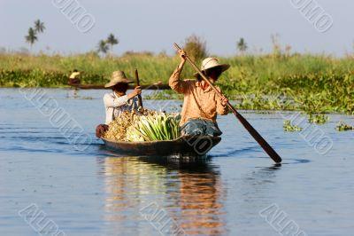burmese women in wooden canoe