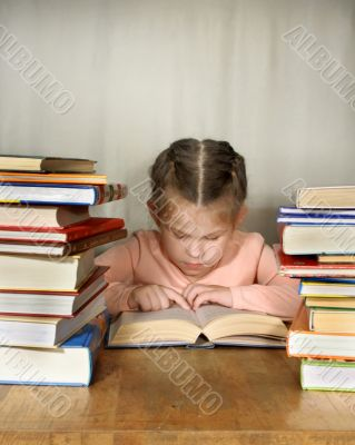 The little girl attentively read