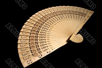 Hand-held fan on black background
