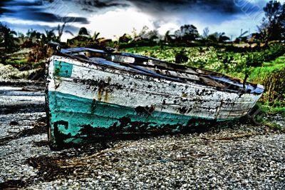 Green White Sailing boat stranded