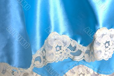 Blue fabric with white lace