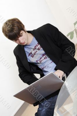 confident young manager at work with laptop