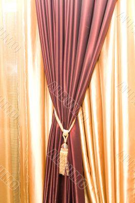 Purple velvet courtain with golden tassel