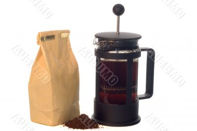 French press with a pack of coffee