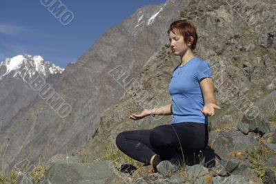 Meditating girl in the mountains 03