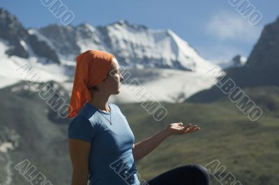 Relaxing girl in the mountains