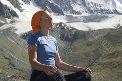 Meditating girl in the mountains 06