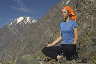 Meditating girl in the mountains 05