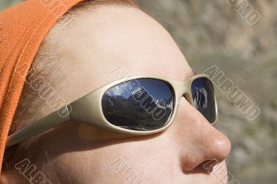 Face with reflection in glasses