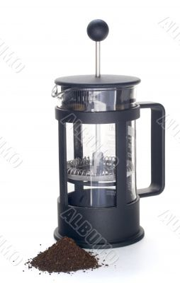 Empty french press with ground coffee