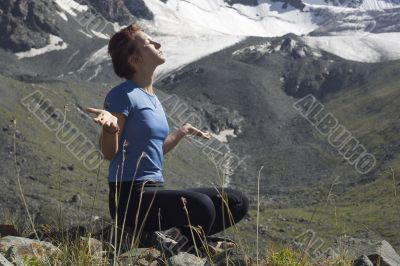 Meditating girl in the mountains 02