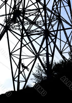 Power tower silhouette and bungee jumper