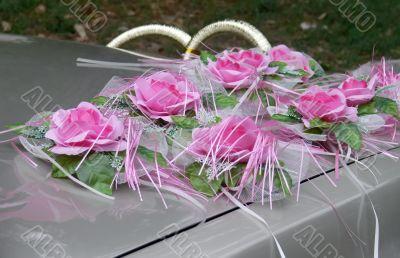 Wedding flowers on a car hood