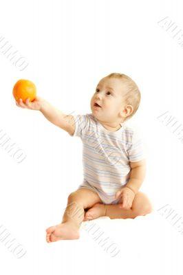 baby boy giving an orange over white