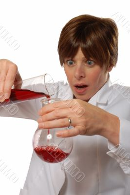 worried lady scientist pouring liquid