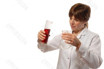 young lady scientist pours liquid