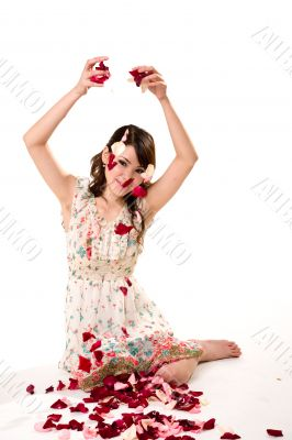 young girl tossing rose petal