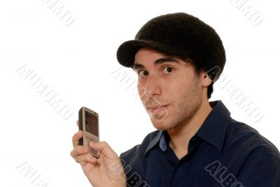 Young man texting on mobile phone