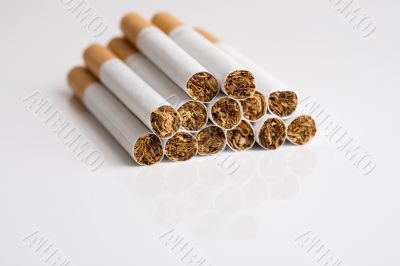 Cigarettes on reflective surface