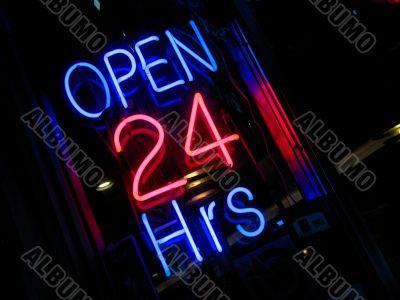 neon `Open 24 hours` sign